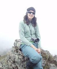 Sasha sits in the clouds on Mt. Kenya.